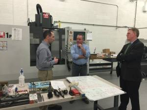 Rep. Roy speaking with instructor Bob Vozzella and Superintendent Steve Dockrey at Tri-County's new advanced manufacturing site.